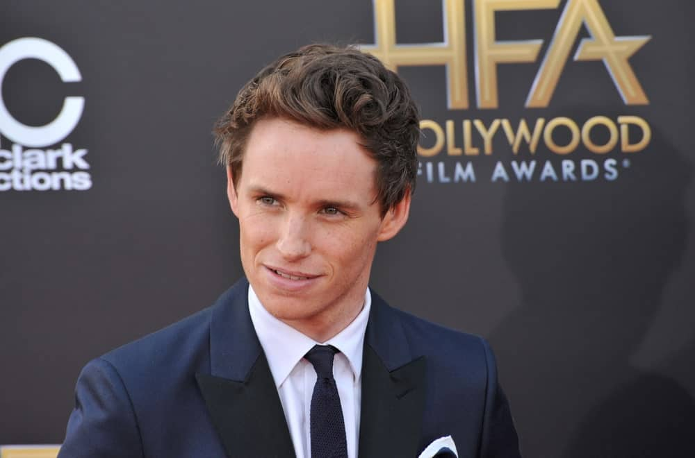 Curly hair like that of Eddie Redmayne can be notoriously difficult to style, but that doesn't mean it won't let you rock a killer slicked-back style. For a modern take on this classic style, you can loosen things up a little. Add lots of texture and volume on the top of the hair and use minimal amounts of products to maintain a natural appearance. You can also use your fingers for a tousled-looking quiff and add some texture sea salt spray to hold the natural waves.