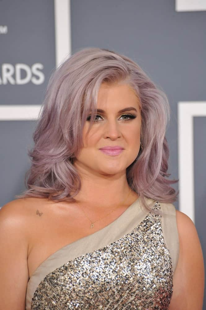 Gray hairstyles couldn't get more elegant than this. Kelly Osbourne sported this stately hair color at the 54th Annual Grammy Awards in Los Angeles. It features a soft and subtle blend of muted mauve tone to create a luxe look.