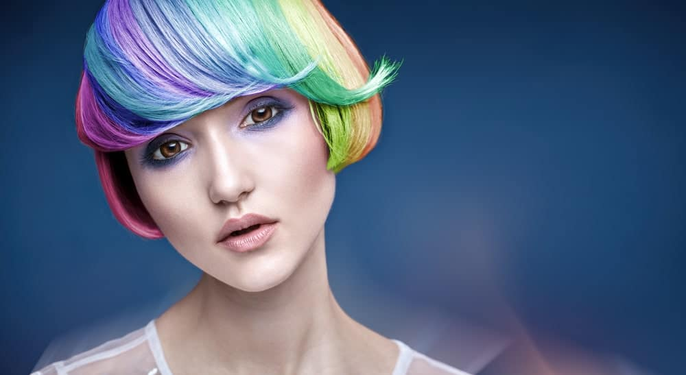 This is an example of a perfect rainbow bob. This model's hair has been meticulously painted with all the colors of a rainbow in a perfect gradient. This is a very fun and summery look and is perfect for going to events like Coachella and Burning Man. But make sure you can invest time in maintaining this beautiful look.