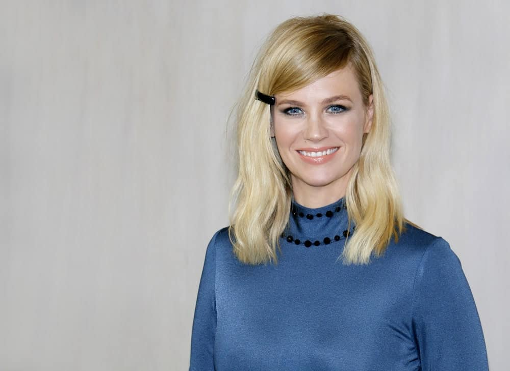 "January Jones is the perfect model for blonde women who need some hairspiration. The ""Mad Men"" actress has donned hundreds of different styles on long, short, and mid-length hair and here is one of our favorites. Jones chopped off her hair till just below shoulder-length and gave it a messy side part. She pinned one side of her hair with a simple clip, giving her a very youthful look. This look is simple, quick to make and looks super adorable."