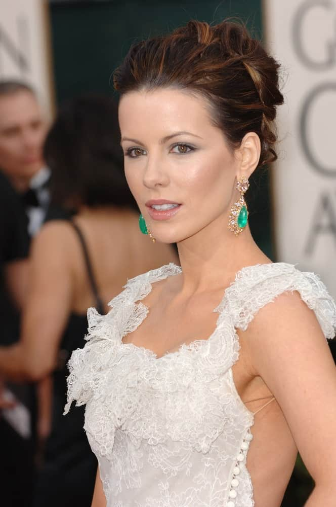 Look exquisite with Kate Beckinsale's brown and black updo that features a high bun fronted with lightly teased strands and a couple of tousled tendrils. This hairstyle is highly convenient and super stylish.