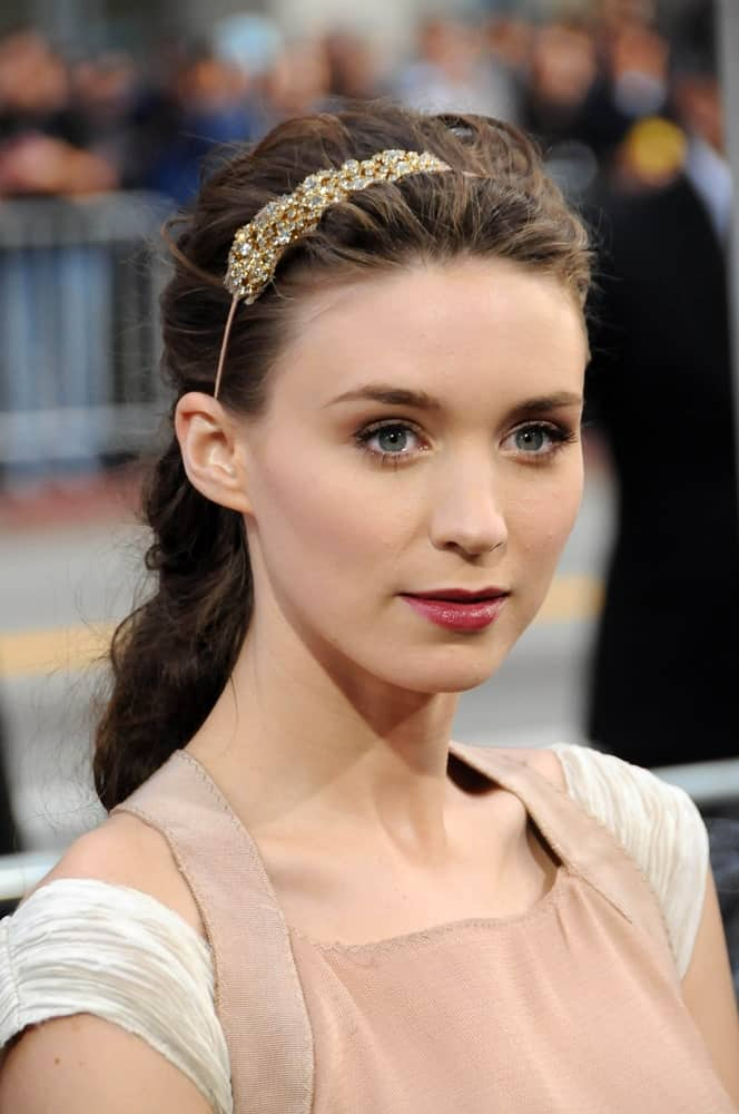 No matter what, half-up-half-down hairstyles will always be in fashion. Take notes from Rooney Mara's impressive hairdo that is suitable for weddings as well. Backcombing her hair gives it more dimensions while a slim and sleek jewel headband exponentially boosts the stunning look.