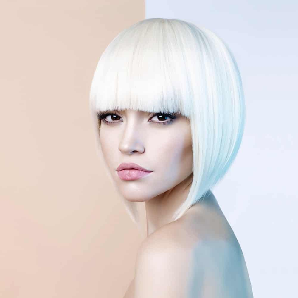 For a sophisticated and futuristic look, make your hair go a brilliant white. Get your stylist to cut it into an angled bob, which ends an inch or two above your shoulders. Perfect the look with straight blunt-cut, eyelash-skimming bangs.