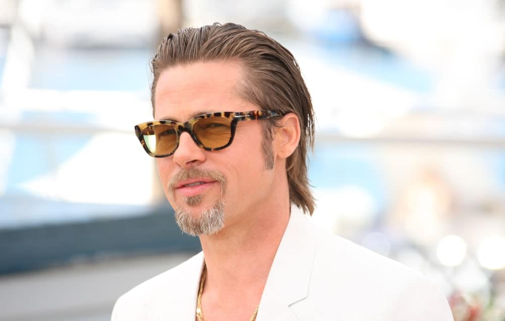 If you want to keep thing super-cool and modern, try this slicked-back style with long hair, like Brad Pitt. The actor added lots of gel product to give his hair a super-wet look. He then pushed it back and combed it down to his shoulders. The look is super casual and super cool and perfect for a day out chilling.