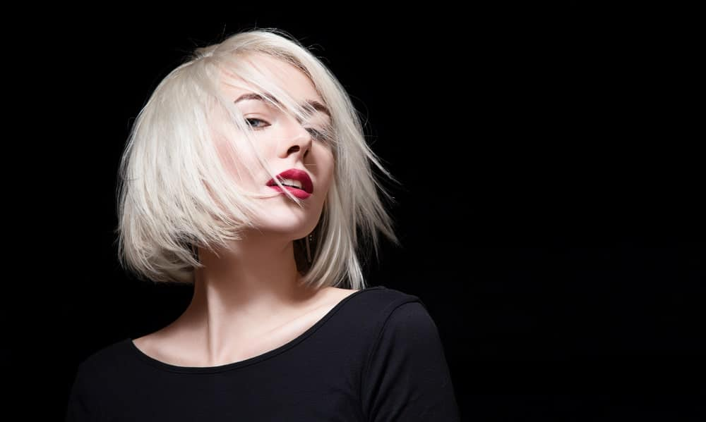 The classic bob cut has made a comeback with a bang and it doesn't seem like it will be leaving any time soon. To give her bob a modern twist, this model has colored it ice-white. Pair it up with red lips to create that oomph factor.