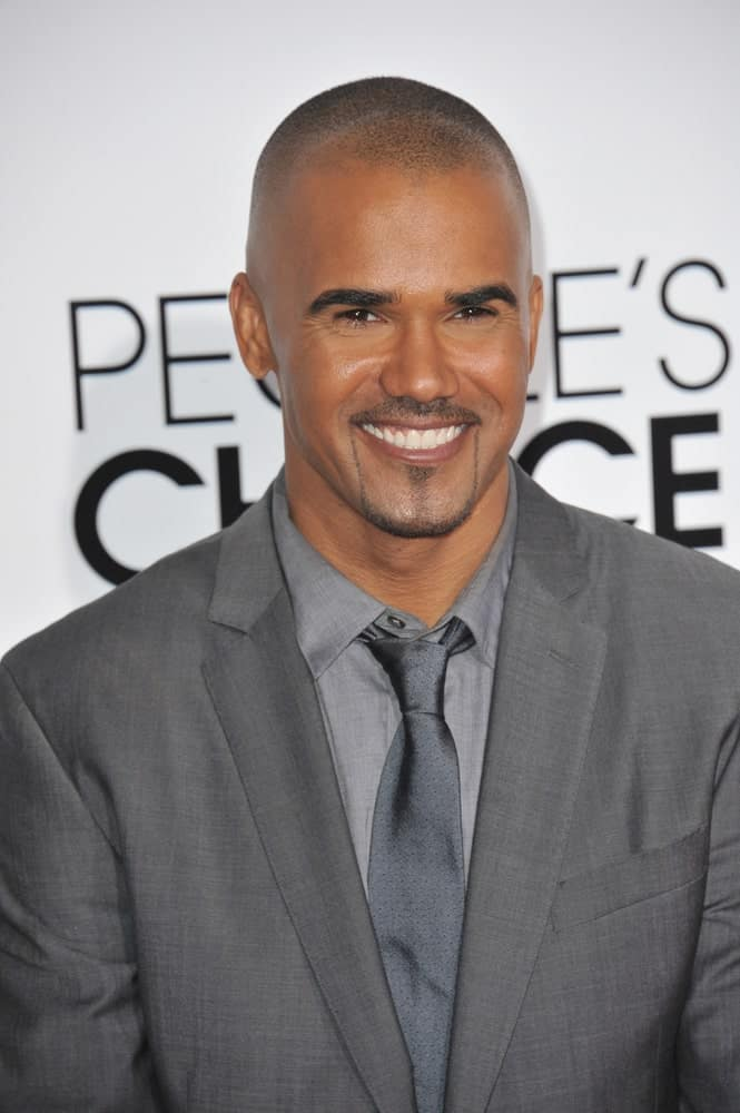Shemar Moore, the super smart and stylish American fashion model looks simply dashing in this shaved haircut. He sports this buzzed and neat hairstyle flawlessly and the French-inspired beard style simply completes the whole look.
