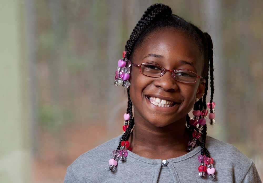 This is one of the favorite looks among young girls. Although the braid patterns are not as elaborate as some other styles, adding lots of colorful beads in varying shapes make this Fulani hairstyle very fun. Just section your hair into two parts from the middle and then weave the hair into Fulani braids. Add cute plastic beads at the end.