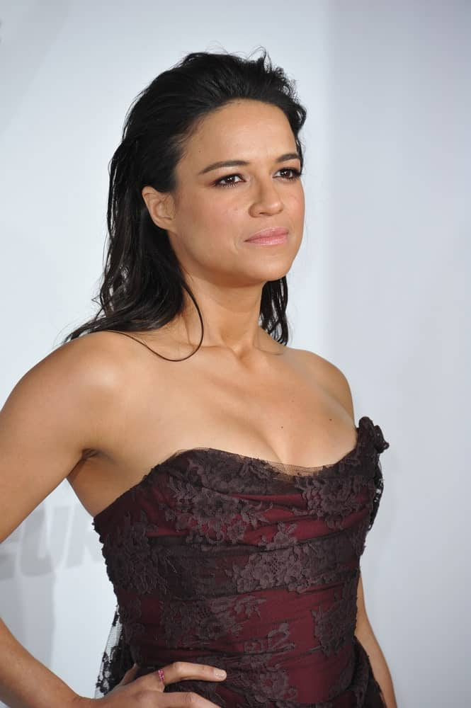 "Michelle Rodriguez prefers to stay out of the limelight; however, when she does go out, she turns head. Here ""The Fate of the Furious"" star has opted to slick back her beautiful dark hair in a messy and wet look. For an actress who is known for playing tough-chick roles, this look is perfect and drives the fact straight home."