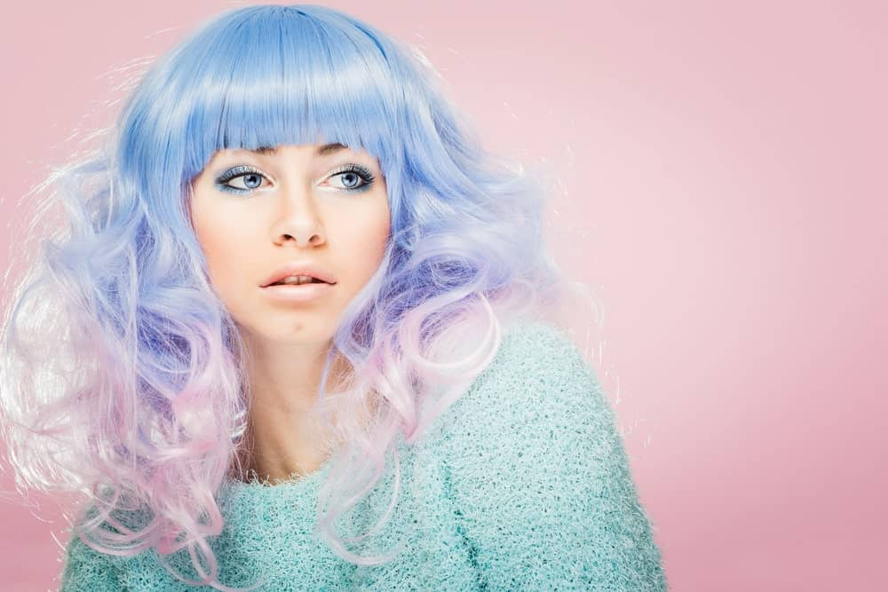 This is a very flirty and adorable look for ladies with superfine hair.  This model rocks pastel periwinkle and candy pink hair which melt together in the middle to give a soft lilac shade. The colors make her hair look like cotton candy and the style is popularized by anime characters.