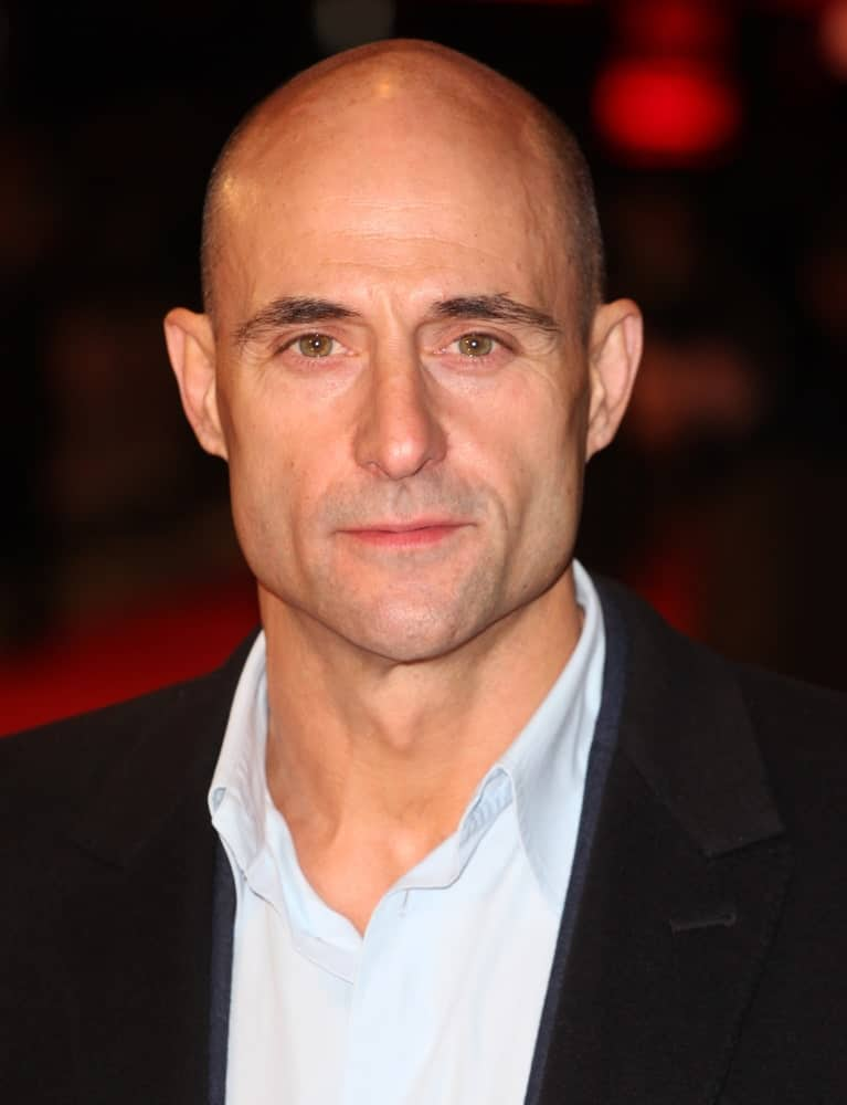With that extraordinarily sleek jaw-line, prominent high cheekbones, and those big gleaming eyes, Mark Strong pulls off this classic shaved head with utter grace and simplicity. The structure and cut of his face make his chin very noticeable, adding to his charisma!