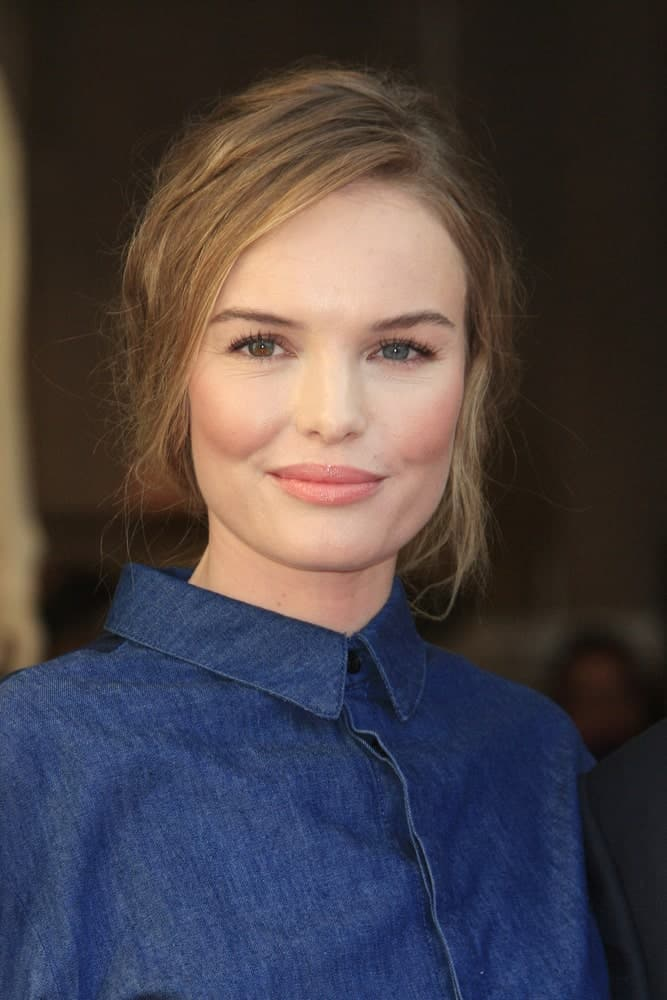 If you are one of those women who are always on their toes to get things done and cannot afford extra minutes in styling your hair, then take some inspiration from the charming Kate Bosworth. She had tied her hair in a regular bun and side-parted the strands at the front before tucking them behind her ears. And just like that, she's set for the day!