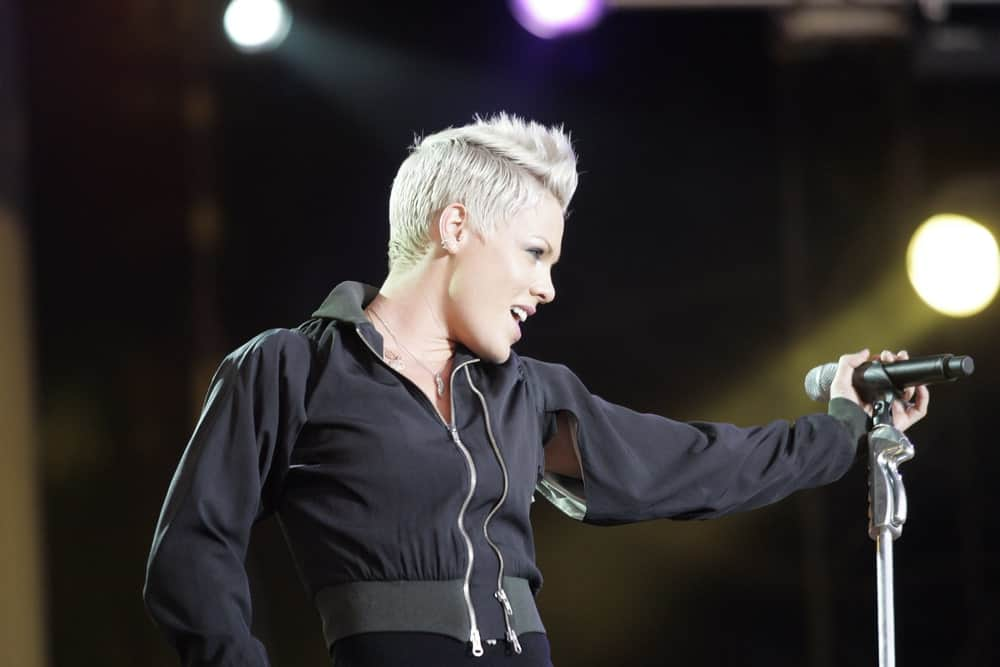 For women who prefer short hair, there are numerous ways to style it. Take a look at Pink's style. The singer has always flaunted short hair but this is one of our favorite looks. Pink has styled her platinum white hair into a super-stylish faux hawk, which goes perfectly with her black outfit and soft makeup.