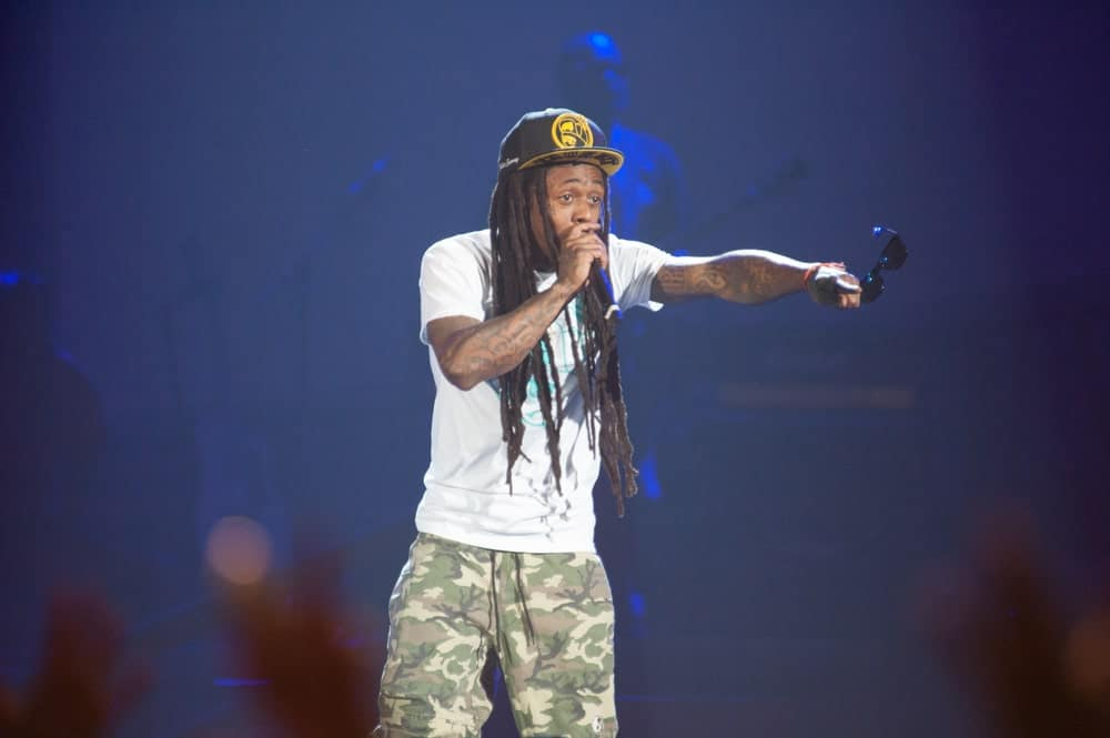 If you fancy super long dreadlocks, perhaps take a leaf out of Lil Wayne's hair book, the ultimately exceptional American rapper. Here he is looking super cool and funky with his uber-long brownish-black dreadlocks that greatly compliment his overall attire. His dreadlocks are very thin and neatly made that make it look even better.