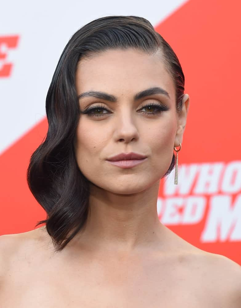 Mila Kunis looks exquisite beyond words in this slick and gelled side-swept hairstyle that resembles a thick black spring hanging at the side. It's a bold and daring style that must be taken into account if you want to set yourself apart from the crowd and look really captivating.