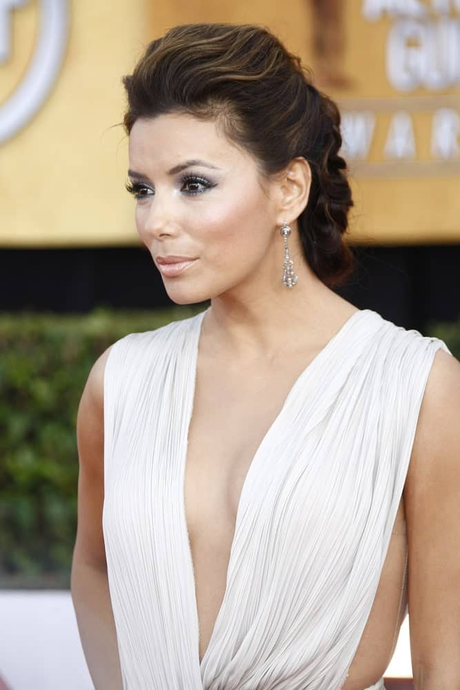 Eva Longoria demonstrates a great style for wedding parties that the bride and bridesmaid would both love to sport. After forming a Dutch braid, she has tucked the end under itself to give her more texture and volume. Babylights help enhance the glam.