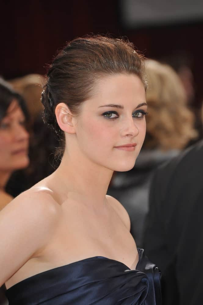 If you are one for minimalism, then consider trying Kristen Stewart's plain French pleat that has been rounded into a bun at the back. This gives you a chic and superior look beside letting your eye-makeup become all the more prominent.