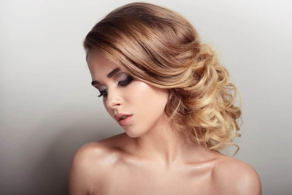 Want to try an elegant party or a wedding-hair look? Wear your mid-length hair in a low bun. It's easy. Keep the top and front of your hair straight, while curling the bottom of the hair around a hot tong to get lots of wispy curls. Then take some bobby pins and either pin your curls to one side or roll them up. Fix the bun to the back of your neck to create this beautiful look!