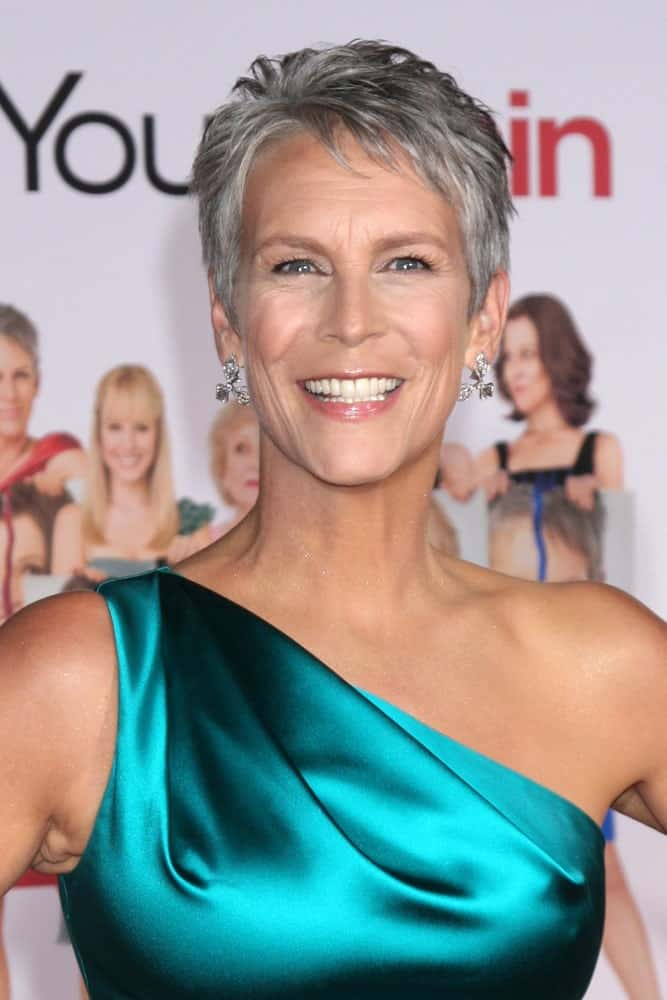 This elegant gray hairstyle for women over 50 is beauty and grace personified. The American actress, author, and activist, Jamie Lee Curtis sported this really short pixie cut with baby bird bangs at the 'You Again' World Premiere in Los Angeles, CA.