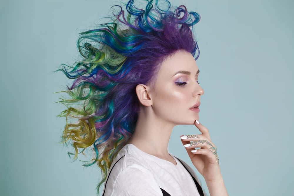 Unlike the fiery colors in the mermaid-style hair above, this hair technique employs darker, more mysterious jewel tones, like dark violet, royal blue, seaweed green, and sandy gold. If you want to go for a dark, edgy mermaid look, these are the colors for you! Old Glory/Superman Bob