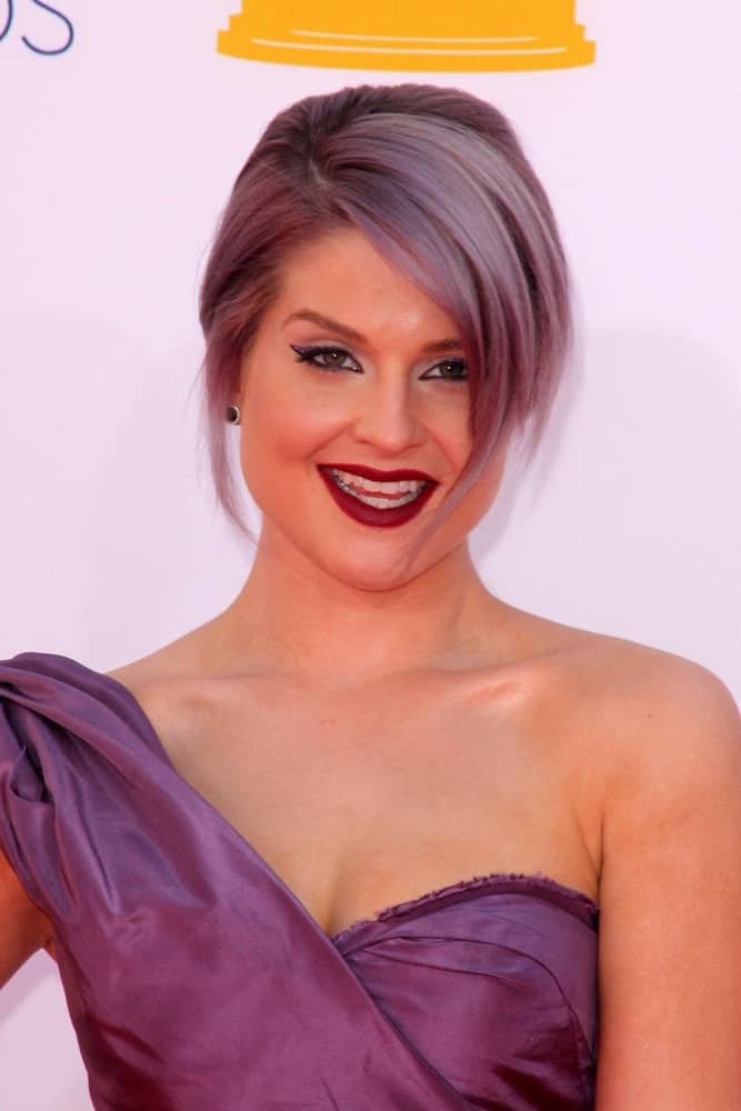 Kelly Osbourne's fascinating side-swept hairstyle will definitely require you to dye your hair, but it's a style worth considering if you are willing to experiment. A spectrum of mauve, lavender and purple hues is the ultimate way to accentuate a side-falling feathery haircut.