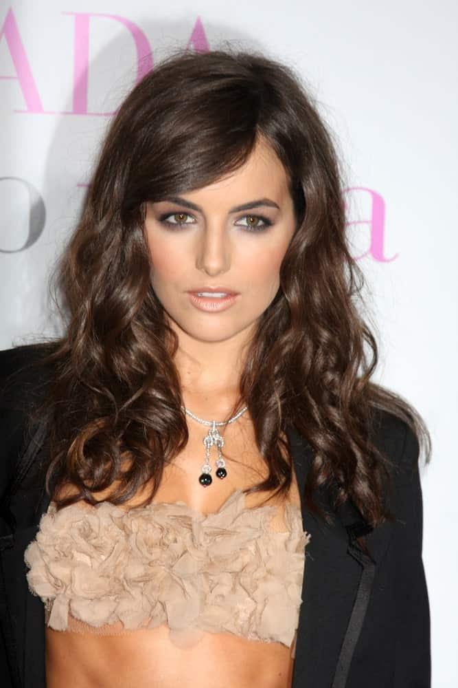 Camilla Belle is a real charmer and here this young beauty has lightly tossed her naturally wavy hair over the shoulders after curling them half-way down. This uncomplicated and trouble-free hairstyle will look equally exquisite no matter what your hair color.