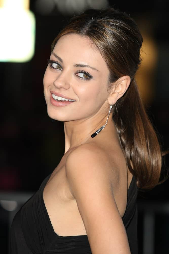 Mila Kunis looks like a true diva showing off her super shiny hair in this modern ponytail hairstyle for women. A well-defined center-part coupled with hair clipped back in a neat bunch is an ideal style to sport on both, casual as well as formal events.