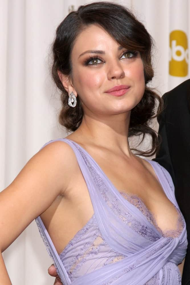 Be it a prom night or a wedding party, Mila Kunis's hanging bun combined with deep, eye-skimming and side-swept bangs will go well on both events.