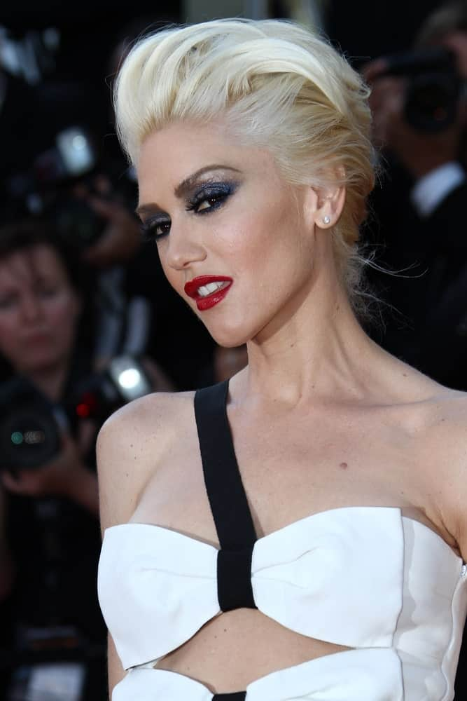 If you have super fine but thick white hair like Gwen Stefani, you can style it in a way that keeps those loose strands off your face. Take some styling products and sweep it through your front hair, pushing it back in an effortless pompadour. This will put more focus on your face.