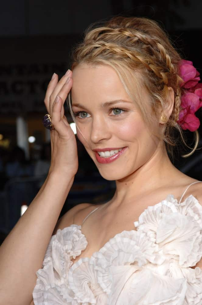 Milkmaid braids are nothing new, but they are a classic plait that never goes out of style and is often incorporated into wedding updos for a soft and fancy finish. Fashion guru, Rachel McAdams, proves the timelessness of this style by sporting not one, but two milkmaid braids in her caramel brown hair. Fresh flowers further turn the style up a notch.