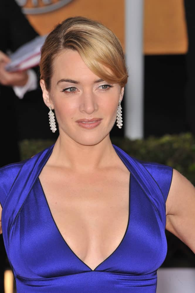 Here we see the famous Kate Winslet oozing beauty and grace in this elegant side-swept hairstyle for women. Securing her hair in a tight bun, the actress has opted for deep and long bangs at the side for a fancier finish.