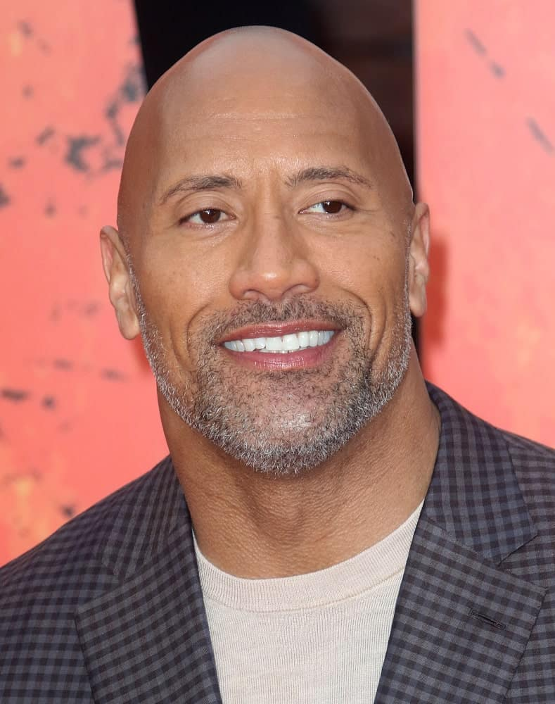 Dwayne Johnson or better known as 'The Rock' has to be one of the most popular celebrities who shaved his head and went bald! His sparkling shaved noggin generated quite a buzz all around the world and the mystery behind him going hairless remained unsolved for quite some time. Until one day, he resorted to Twitter to explain his decision to go bald. He tweeted: I'm not bald because I went bald. I'm bald because my hair is a cross between an afro and hair from a llama's ball sac!""