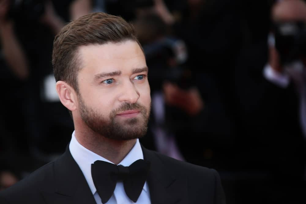 Just because you want a slicked back style, doesn't mean you need to add a gallon of hair product to your hair. For those who don't like the heavy feeling that can come with using too much styling pomade, Justin Timberlake's minimal product look is the best. The singer's barber styled his sides in a low-fade, and gave his full top hair a subtle slick with lots of brush-overs. This is one of the best red-carpet's hair looks.