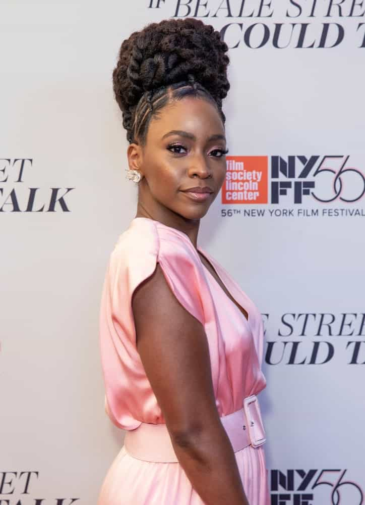 """Beautiful actress, Teyonah Parris, debut this stunning look at the 2018 New York Film Festival. The """"Survivor's Remorse"""" actress styled her hair in a very elegant way, opting for only a few strands of Fulani braids at the front of her head, weaved in geometric patterns. The rest of the actress' thick, natural hair was twisted in a thick braid, curled up and turned into a stunning bouffant bun at the top of her head."""