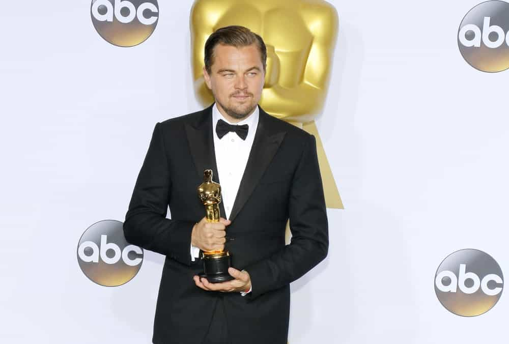 """Want an Oscar-worthy look? Get a cue from Leonardo DiCaprio. The """"Revenant"""" star usually turns heads on the red carpet,and a lot of that has to do with his hair. While being awarded the Academy Award, the actor sported a classic comb-over look. Combined with his prominent widow's peak, the hairstyle looked pretty elegant and dramatic."""