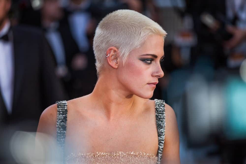 Did you know that white hair could look this good even in a buzz cut? If you are not a fan of long hair and like a little breeze on your neck, it's time you chop off those long locks – just like Kristen Stewart. Just keep a few millimeters of your hair and color it white to give you a super-edgy look. This hairstyle does wonders for defining your jawline.