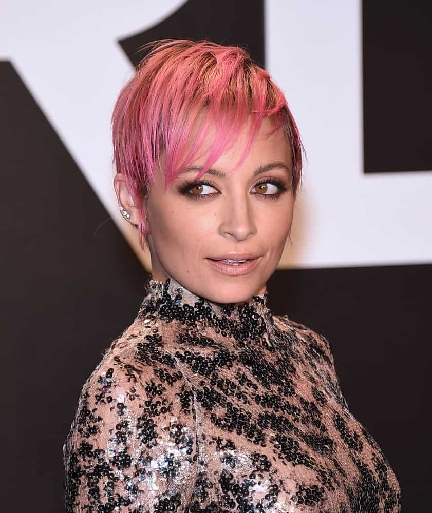 The pixie hairstyle is not going away any time soon as celebs come up with more and more new ideas to hype up the classic cut. Here, Nicole Richie rocks a pixie cut with piece-y bangs that are dyed a fiery pink color. This vibrant hairstyle works great with minimal makeup. Mint and Lime Green Hair
