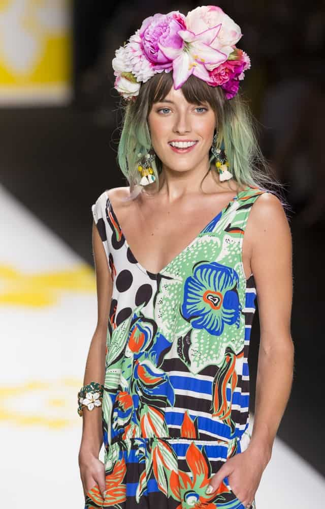 Model Chloe Norgaard gives tribute to nature as she walks the catwalk in mint and lime-green hair, adorned with a wreath of flowers. The model has her hair cut to shoulder length in a simple medium-length bob and rocks the style with a floral-printed dress. This is a wonderful look for spring. Silver-Lilac Pompadour