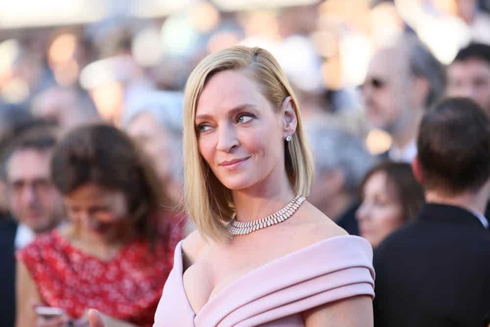 "Uma Thurman has opted for a simple style that turned out to be super chic — just like the actress herself. The ""Kill Bill"" actress cut her hair into a classic blunt bob. The actress gave her hair a deep and straight side part. One side of the hair is secured behind her ear while the other is let loose to frame her face. The look is very sleek and chic."