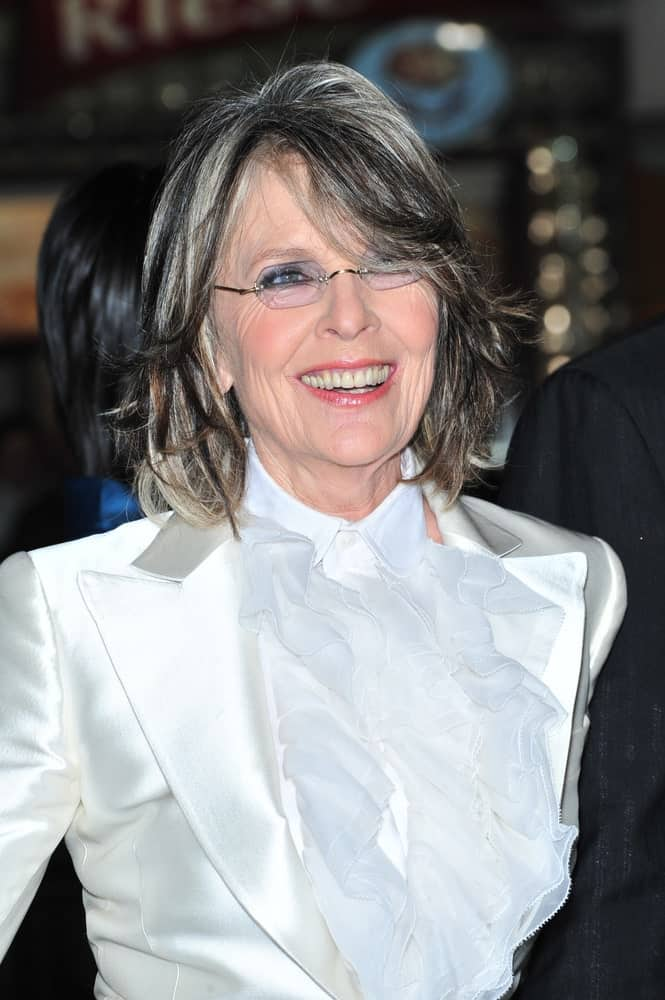 Graying of hair is a natural phenomenon and bound to occur at some point or another. So, when your hair starts turning white, you have two options: panic and shy away from the change or embrace it with boldness and style. For instance, Diane Keaton demonstrates that salt-and-pepper hair actually evokes beauty and grace and make you look wise and smart.
