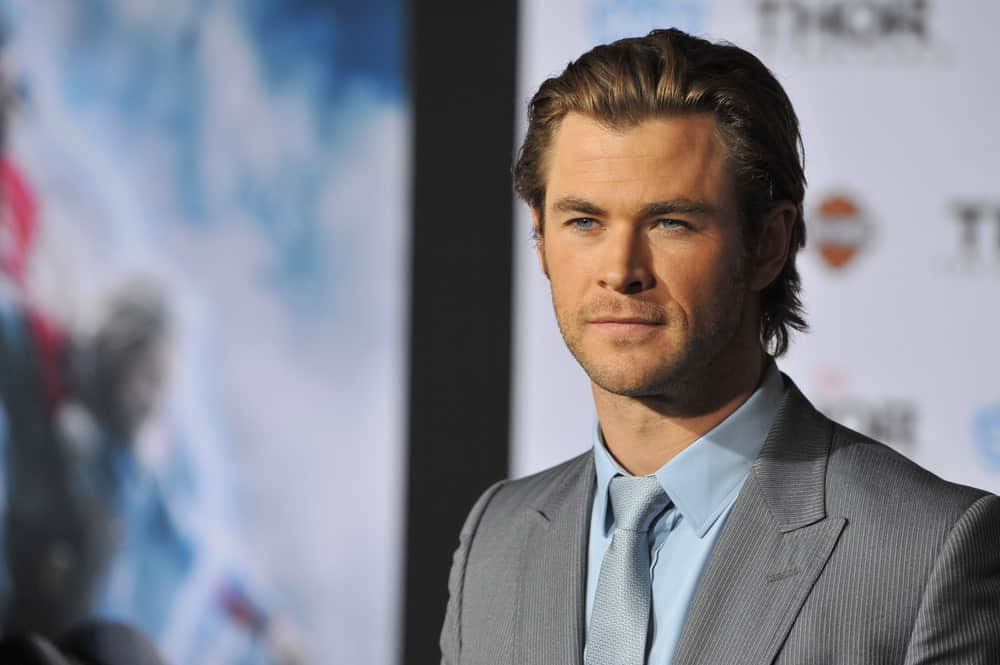 With his rugged good looks, it is no wonder that Chris Hemsworth is one of the most popular actors of the Marvel Cinematic Universe. When he is not playing Thor, the actor cleans up very nicely in a tuxedo and slicked-back hair. Here, the actor has pushed back his brown waves and added just enough styling product to ensure his hair stay in place. His hair was also given some texture and volume so that it doesn't seem plastered to his head.