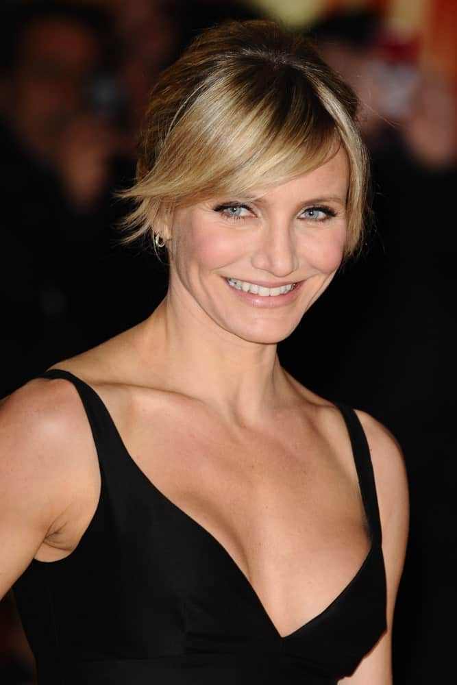 Cameron Diaz dropped some great tips for women who love bangs and/or short haircuts. The long, pointy side-swept bangs that cover her forehead are a good way to bring out the angles of her face whereas a well-arranged bun gives the illusion of short hair.