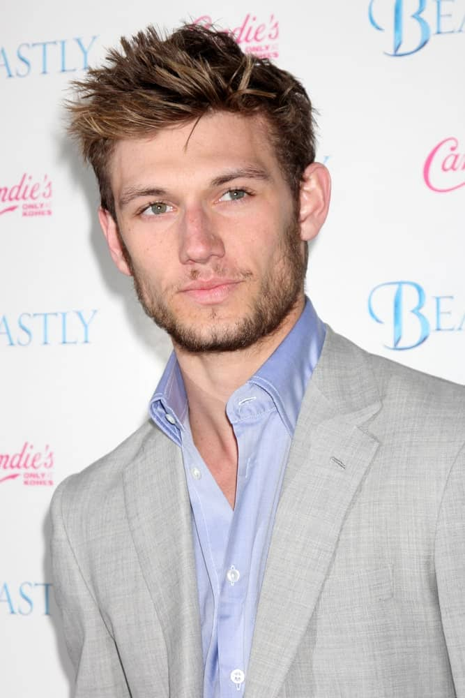 Alex Pettyfer is one of those very few male celebrities with a perfectly chiseled jaw line and complimentary high cheekbones. His hair is also always on-point and here he is, with his short, spiky hair that has been colored a dark brown with hints of very subtle and light gold highlights that pop from within the dark portions of the hair.