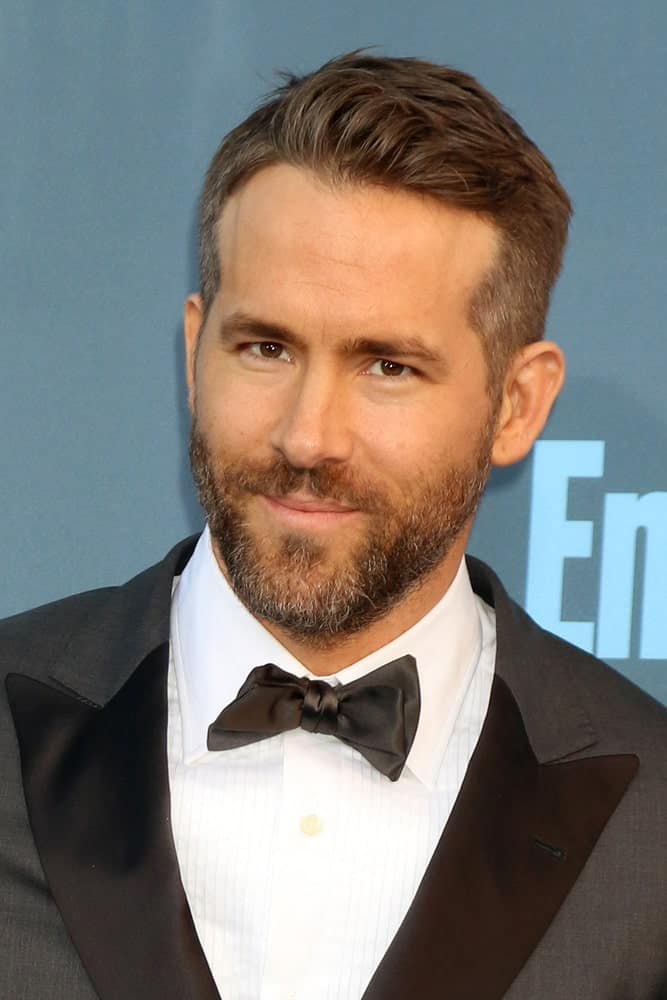 Take some inspiration from Ryan Rodney Reynolds if you are looking for a minimalistic, no-fuss hairstyle for men – one that doesn't demand much time and attention but still makes you look smart and handsome. The side hair is shaved off just as in a buzzcut whereas the pinnacle is cropped to a length that provides enough volume but hardly requires you to even brush it even once – it's just manageable on its own.