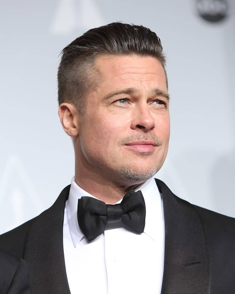 While his military-themed fade haircut for men made it big time, Brad Pitt's slicked-back fade haircut is relatively less known. The style is not particularly new but is still favored amongst men looking for an uncomplicated and trouble-free haircut that can make them look effortlessly stylish. Slathering some gel and brushing your center hair all the way is also useful if you are growing your hair out after a buzzcut or a minimalistic fade that you might have gotten at some earlier time.
