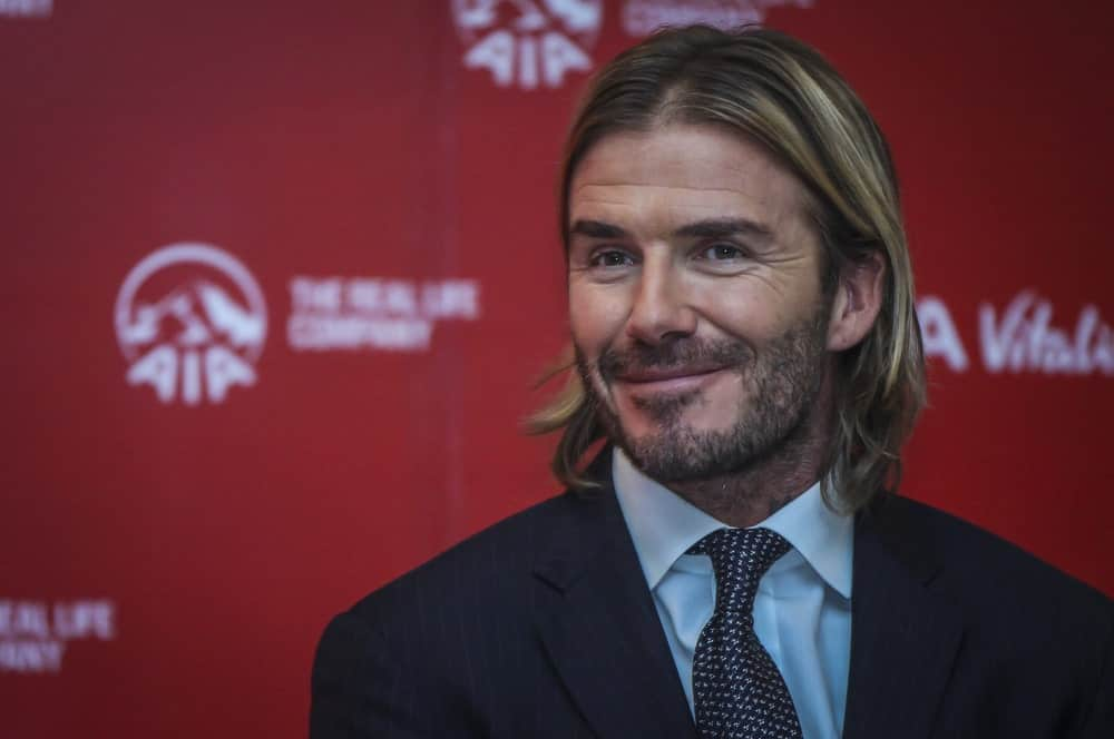 Once upon a time, the super famous professional footballer, David Beckham also had long hair, and he looked nothing short of handsome and sexy at the same time! His hair was just above his shoulders and was parted down the middle. He also had really nice and subtle blonde hair highlights with dark undertones and a mustache scruff that, when combined with his long locks, looked like a match made in heaven.