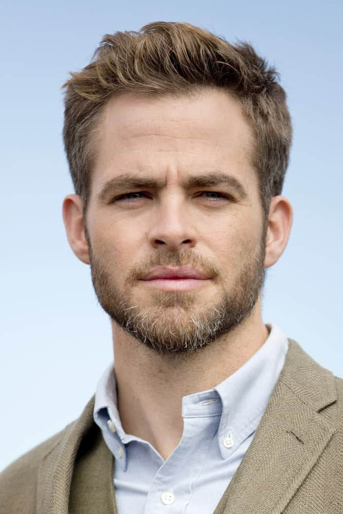 Chris Pine looks truly handsome in this hairstyle of his in which he has soft brown highlights going on all over his hair. His hair is incredibly short from the sides and a little longer from the front where the highlight color pops and looks really cool.