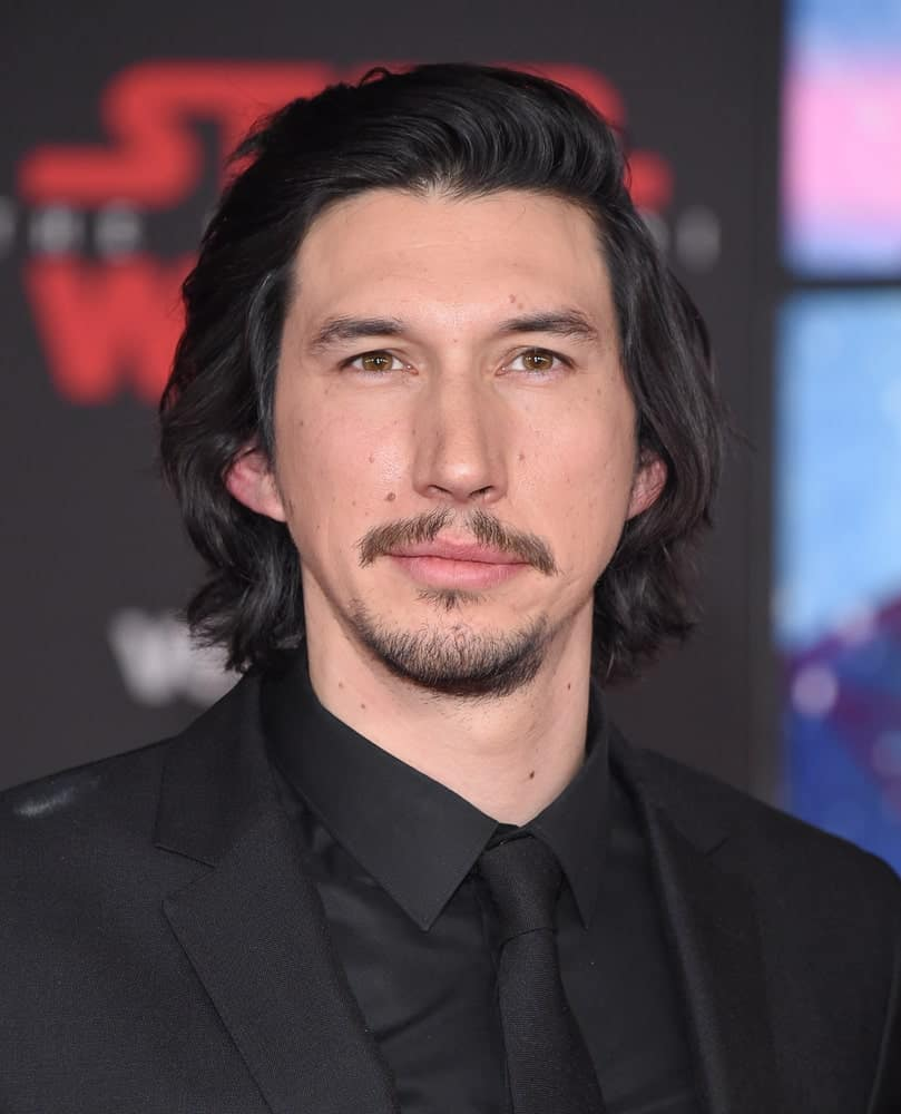 If you are looking for ways to work your long hair as an everyday style and fashion statement, do it like Adam Driver does! He has a shaggy cut that is low-key yet long that looks super casual but can also easily be turned into a fancy hair updo. Those thick, jet black tresses really do look unique, and they also stand out from the rest.