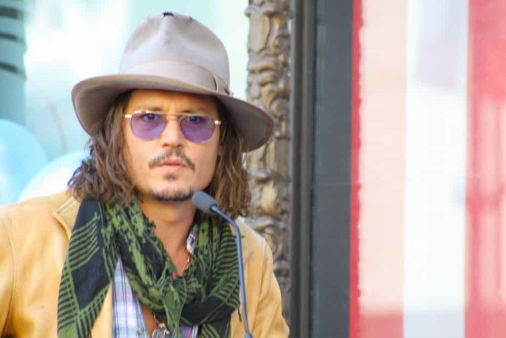 As if Johnny Depp didn't drive us crazy enough with his terrific performance in the Pirates of the Caribbean, now he keeps doing the same with his funky, highlighted hair. With hair that is almost reaching his chin, he has some really subtle light brown hair highlights going on here that greatly compliment his skin tone. His hair is a little towards the wavy-curly side that help bring out the color of the highlights.