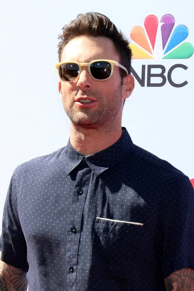 Adam Noah Levine is one of those Hollywood stars who promote fade haircuts as their go-to style. However, this lead singer for the pop rock band Maroon 5 prefers a rather subtle fade haircut. Instead of a well-defined line between the long and short strands, this lead vocalist has opted for a more gradual decrease in hair length from the center to the sides. This style is good for men looking for a fade that does not expose the scalp as the hair isn't chopped down too close to the skin.