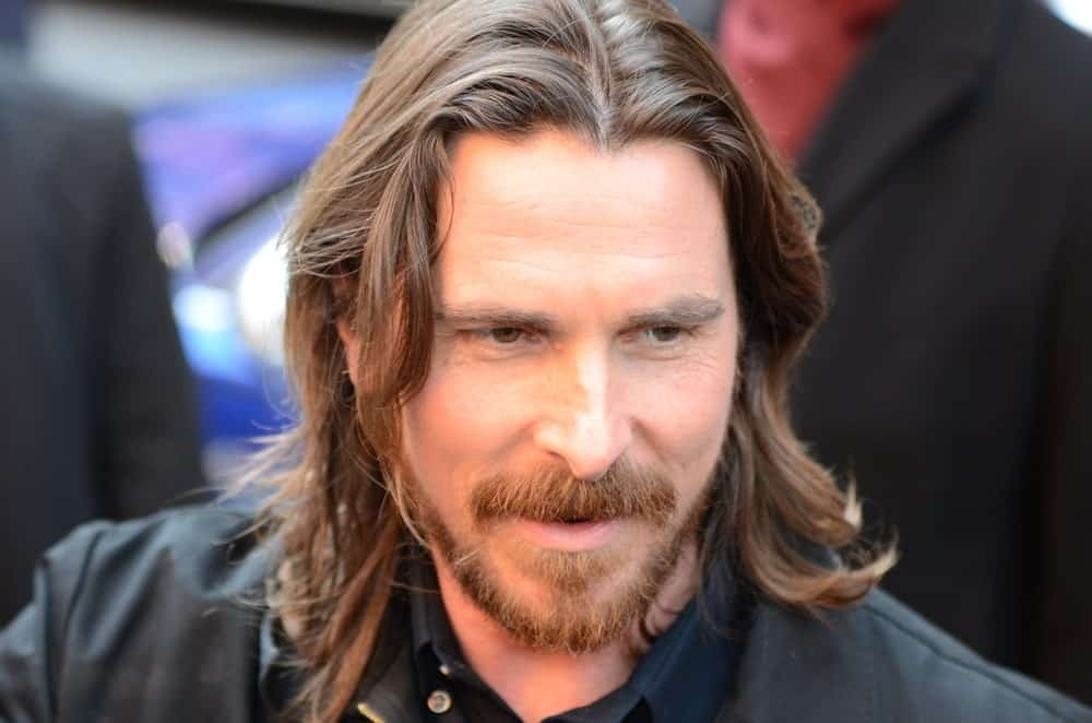 Christian Bale is one of those people who look good regardless of what they do with their hair or face. Here, he is with his hair going all the way to his shoulders with a neat parting in the middle. His hair is a very nice, light shade of brown that looks really amazing with this length of hair.